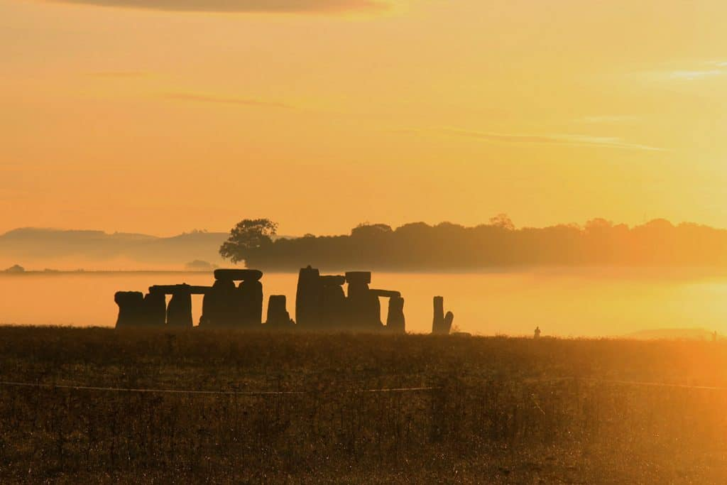 Stonehenge. One of the most iconic landmarks in England, if not the world. If you're lucky, you can watch the most incredible sunrise over these stones- it was one of the most magical mornings in my life. Just watch the video to see for yourself! #stonehenge #england #roadtrip #traveltips #adventure #beautifulplaces #UK #travel