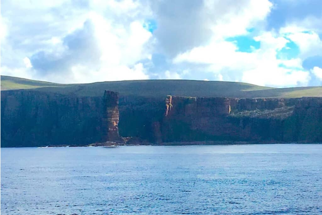 How to get to Orkney by ferry- Sailing past the Old Man of Hoy on the ferry to Orkney