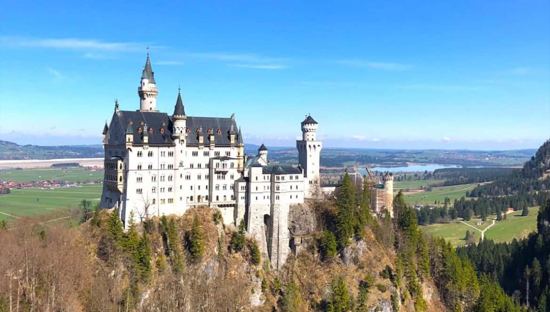 Neuschwanstein Castle Complete Guide. Visit Neuschwanstein Castle- this guide will show you how to see the fairytale castle up close! #neuschwanstein #neuschwansteincastle #disneycastle #fairytalecastle #castle #germany #traveltips #travelblog #wanderingbird #roadtrip #castles #fairytale #disney