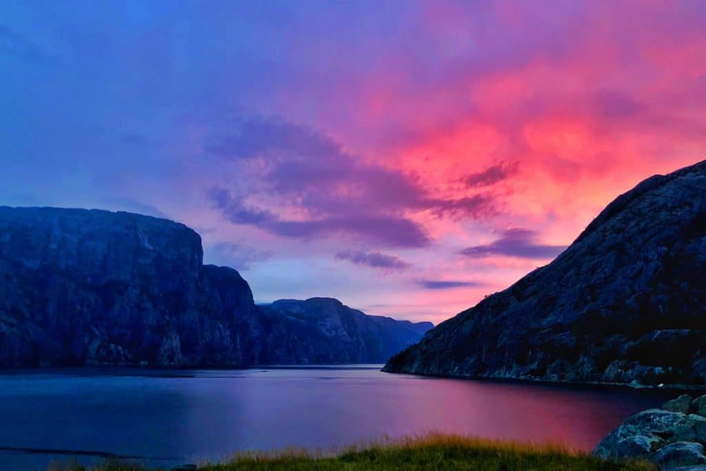 A view of the sunset over a Norwegian fjord while wild camping in Norway with a motorhome.