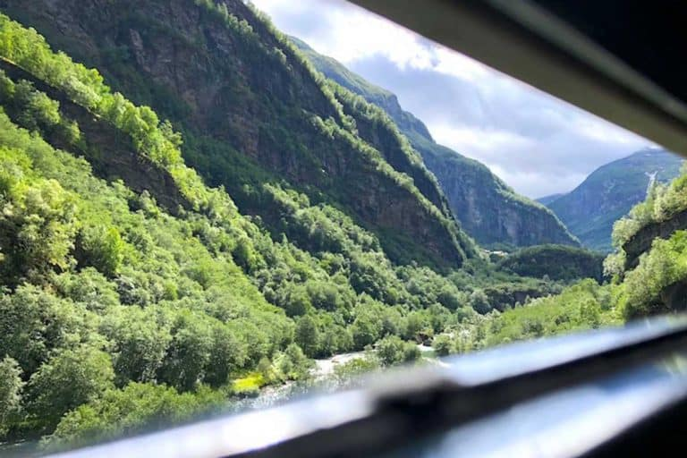 Is the Flamsbana railway in Norway REALLY the most beautiful railway ride in the world? Should you go out of your way to visit Flam during your Norway travel? Here's everything you need to know about riding Flamsbana railway in Norway #norway #flam #flamsbana #railway #beautifulplaces #thingstodo #traveltips #trainjourney