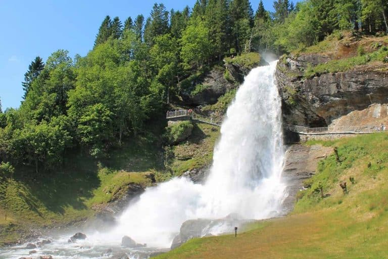 Steinsdalsfossen Waterfall in Norway is AMAZING- you can actually walk BEHIND the waterfall. It's one of the best things we did on our road trip to Norway. Definitely add it to your itinerary! #norway #steinsdalsfossen #roadtrip #waterfall #thingstodo #traveltips #roadtriptips #beautifulplaces