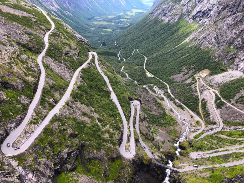 Ever heard of Norway's crazy road? 11 hairpins bends going up the steep side of a mountain!?!?! We rode Trollstigen road on a motorbike- and it was EPIC! Add Trollstigen road to your Norway itinerary immediately! #trollstigen #norway #roadtrip #tips #crazyroad #trollsladder #motorbike #vanlife