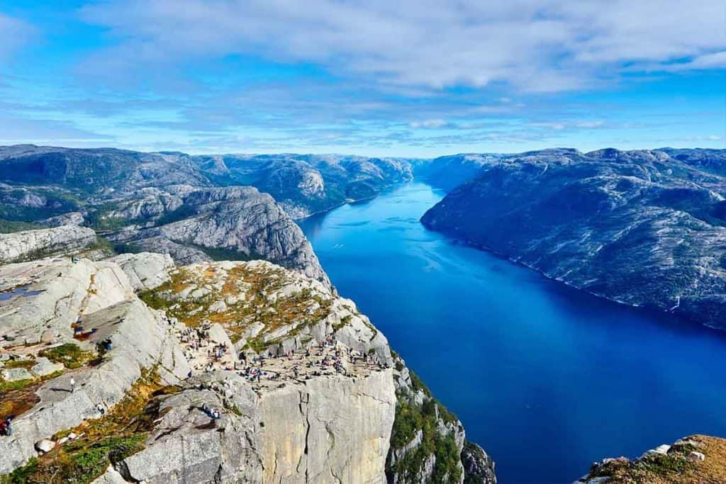A stunning view of the expansive fjords filled with blue water that you'll find in Norway!
