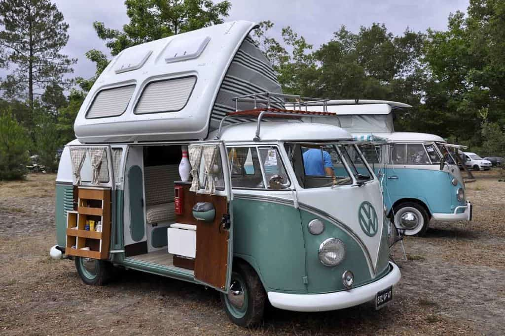 A small, green, VW campervan.