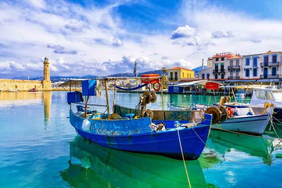 Fishing boats sitting in the water in Crete, Greece.