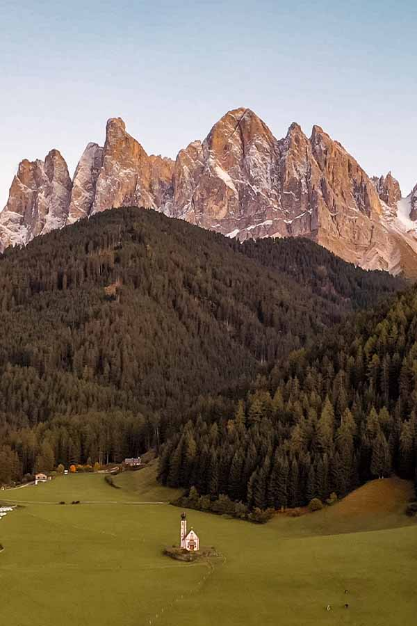 St Johann Church Dolomites- church in field with mountains behind- famous Instagram church