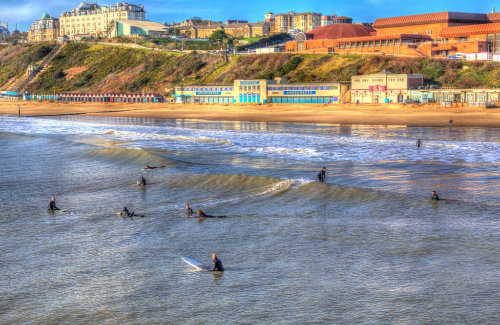Surfing on Bournemouth Beach- one of the best things to do in Dorset